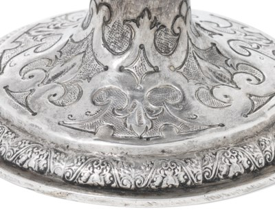 A JAMES I SILVER-MOUNTED COCON