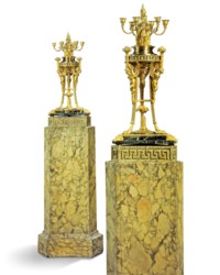 A PAIR OF DIRECTOIRE ORMOLU, PATINATED-BRONZE AND MARBLE SIX-LIGHT CANDELABRA