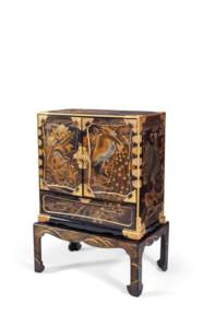 A JAPANESE LACQUER CABINET AND
