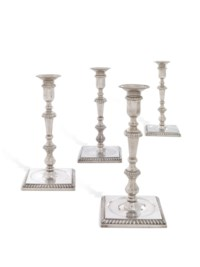 A SET OF FOUR GEORGE II SILVER CANDLESTICKS