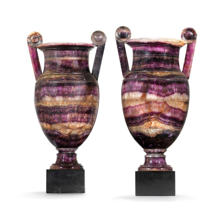 A pair of regency Blue John vases, Derbyshire, circa 1815-20, possibly by William Shore. 15¼  in (38.7  cm) high, overall; 7 in (19  cm) wide; 6  in (15.2  cm) deep. Estimate £60,000-100,000. Offered in The Collection of Drue Heinz Townhouses in London and New York with interiors by John Fowler and Renzo Mongiardino on 4 June 2019 at Christie's in London