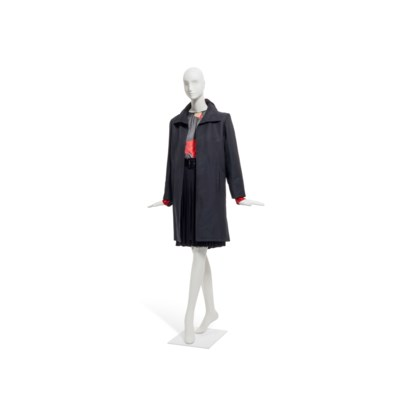 5d95a1cca5c YVES SAINT LAURENT HAUTE COUTURE, A BLACK COAT WITH A PLEATED SKIRT AND A  PRINTED SILK BLOUSE | Christie's