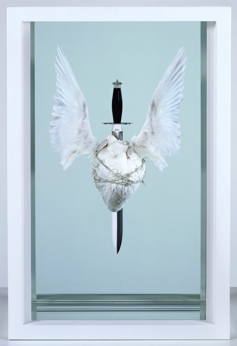 Damien Hirst (b. 1965), The Immaculate Heart♥Sacred, executed in 2008. Acrylic, painted stainless steel, stainless steel, resin, silicone, sterling silver barbed wire, monofilament, bulls heart, doves wings and formaldehyde solution. 36 x 24 x 11½ in (91.5 x 61 x 29.2 cm). Estimate £120,000-180,000. Offered in The George Michael Collection Evening Auction on 14 March 2019 at Christie's in London