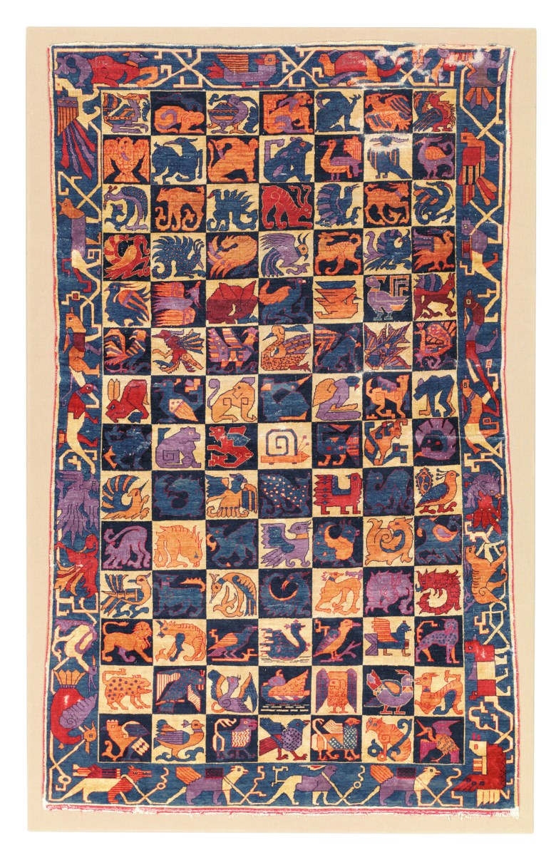 A silk heraldic rug, possibly Kashan, Central Persia, early 20th century. Unmounted 6 ft 4 in x 3 ft 8 in (198 cm x 116 cm). Mounted 6 ft 8 in x 4 ft 3 in (209 cm x 132 cm). Estimate £25,000-30,000. Offered in The Oliver Hoare Collectionon 25 October 2019 at Christie's in London