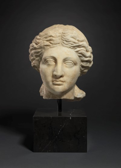 A GREEK MARBLE PORTRAIT HEAD OF A WOMAN