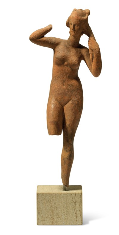 A GREEK TERRACOTTA FIGURE OF A
