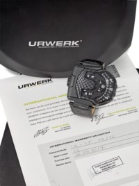 Urwerk. A fine and unusual black PVD-coated titanium reversible wristwatch with wandering hour display, certificate and box