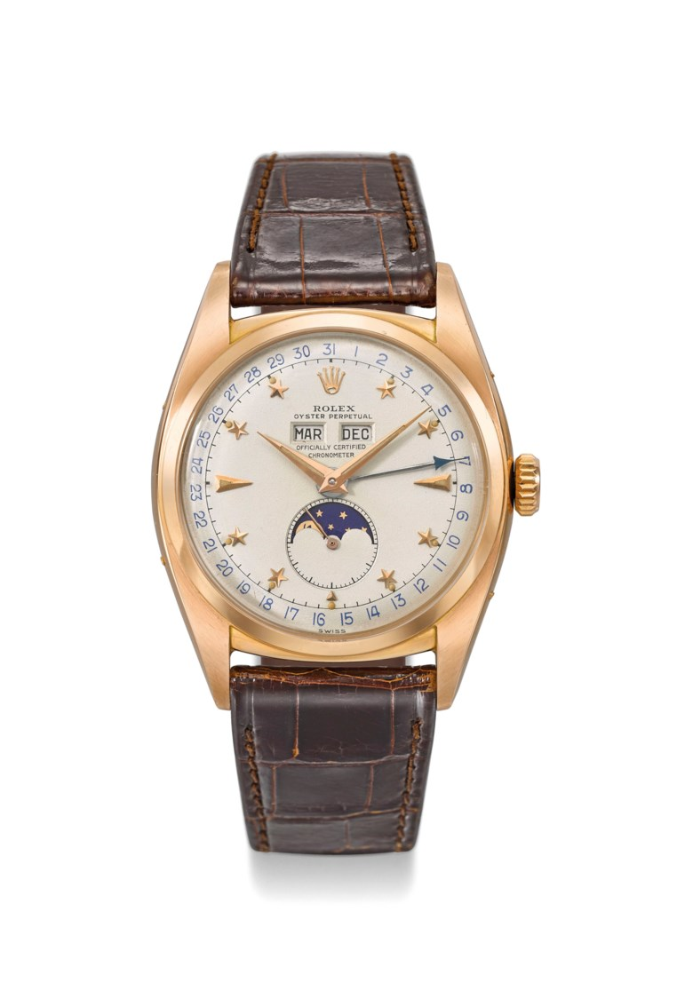 Rolex. An extremely rare and important 18k pink gold automatic triple calendar wristwatch with moon phases and star dial, circa 1952. 35 mm  diameter, signed Rolex.