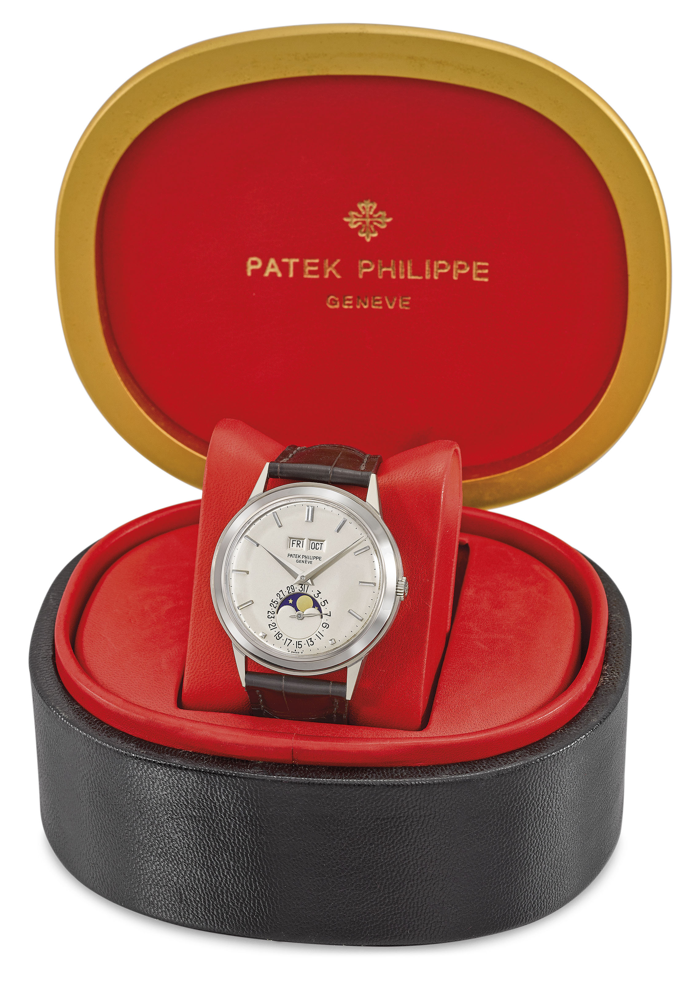 Patek Philippe. An extremely fine, very rare and highly attractive 18K white gold automatic perpetual calendar wristwatch with moon phases and box