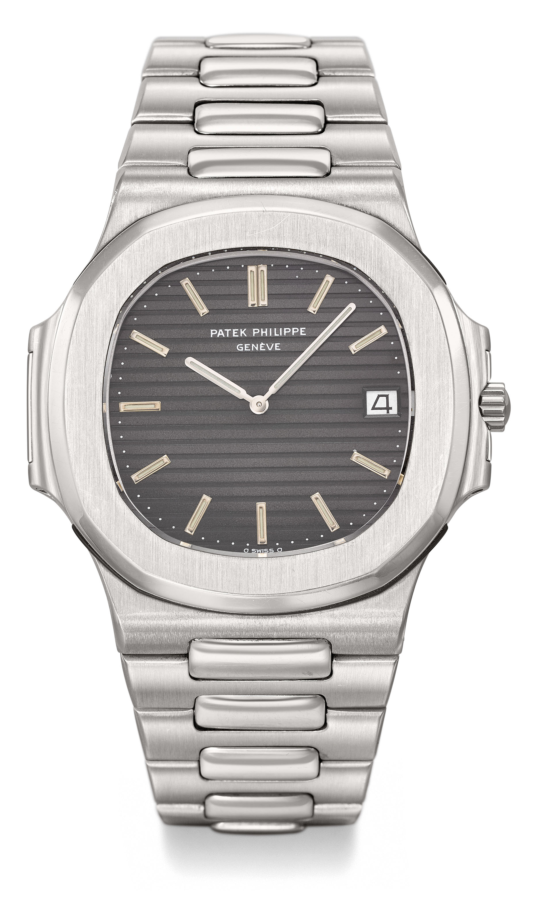 Patek Philippe. A fine and very rare stainless steel automatic wristwatch with date and bracelet, certificate of origin and cork box