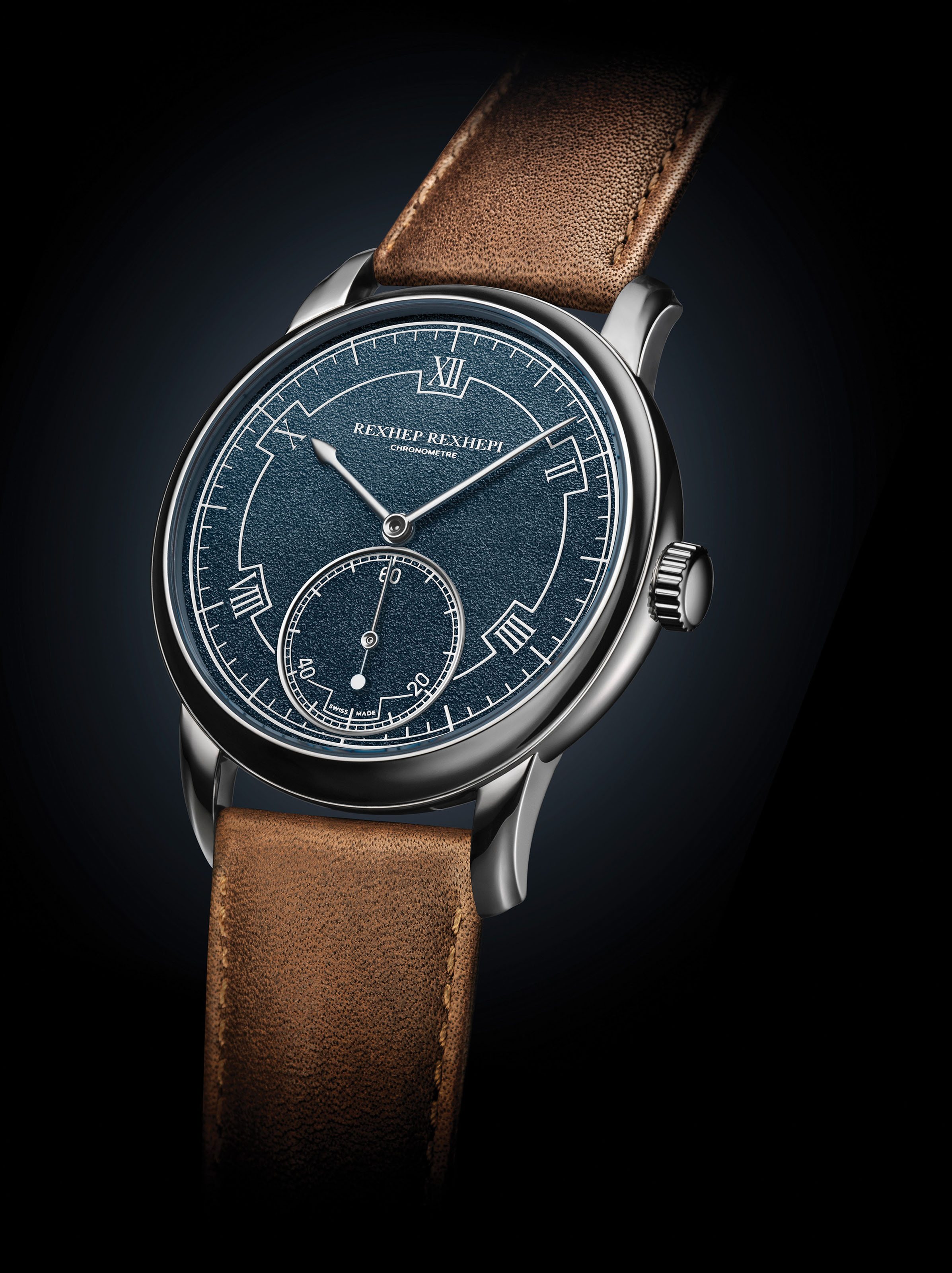 Akrivia. Chronomètre Contemporain Only Watch with unique blue-grey enamel dial and hand-hammered surface. Signed Rexhep Rexhepi, platinum case by J.P. Hagmann. Sold for CHF 360,000 in the Only Watch auction on 9 November 2019 at Christie's in Geneva