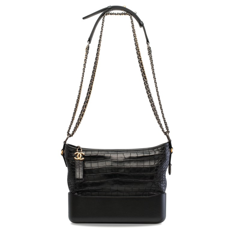 A matte black alligator and calfskin leather Gabrielle Hobo with silver & gold hardware, Chanel, 2018. 28 w x 21 h x 10 d cm. Sold for HK$81,250 on 29 May 2019 at Christie's in Hong Kong