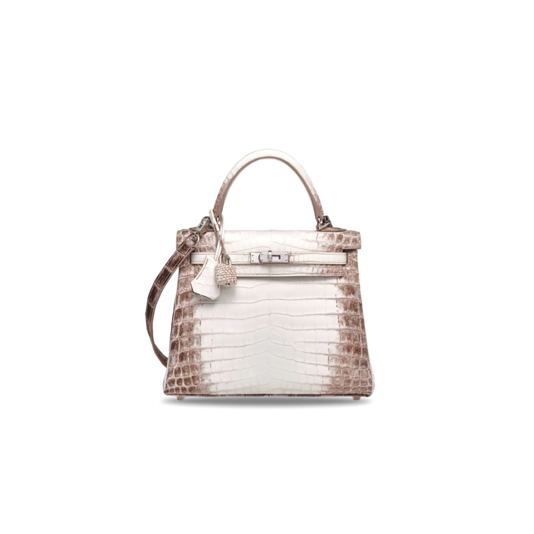 A rare, matte white Himalaya Niloticus Crocodile Retourné Kelly 25 with palladium hardware, Hermès, 2019. 25 w x 18 h x 9 d cm. Estimate HK$600,000-800,000. Offered in Handbags & Accessories  on 25 November 2019 at Christie's in Hong Kong