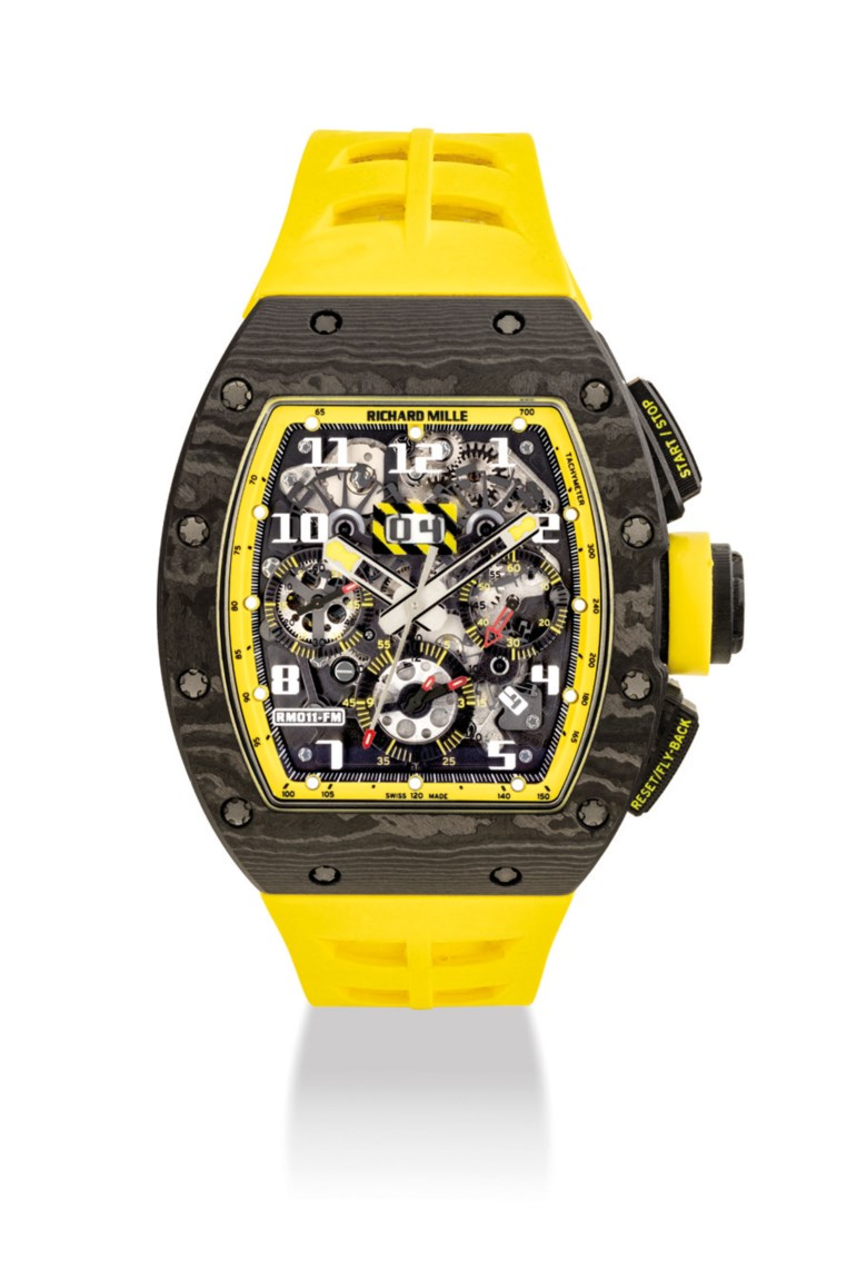 Richard Mille. A very fine and rare NTPT® limited edition tonneau-shaped automatic skeletonised flyback chronograph wristwatch with annual calendar, signed Richard Mille, Felipe Massa model, no.0050, ref.RM011 AO CA. Case 41.5 mm wide, 50 mm overall length, signed. Sold for HK$1,875,000 on 27 May 2019 at Christie's in Hong Kong