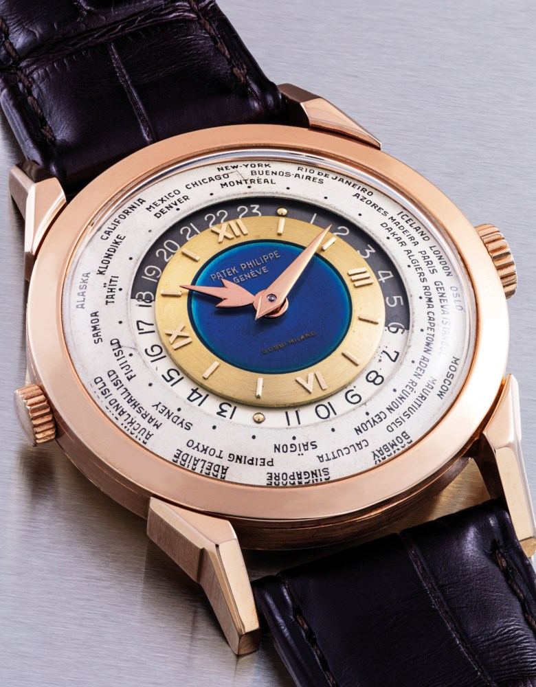 Patek Philippe. An exceptional, unique and highly important 18k pink gold two-crown world time wristwatch with 24-hour indication and double-signed blue enamel dial, Signed Patek Philippe, Genève, retailed by Gobbi, Milan, 'Heures Universelles', ref. 2523, movement no. 722715, case no. 306216, manufactured in 1953. Offered in The Masterpiece Auction (23 Nov)  Important