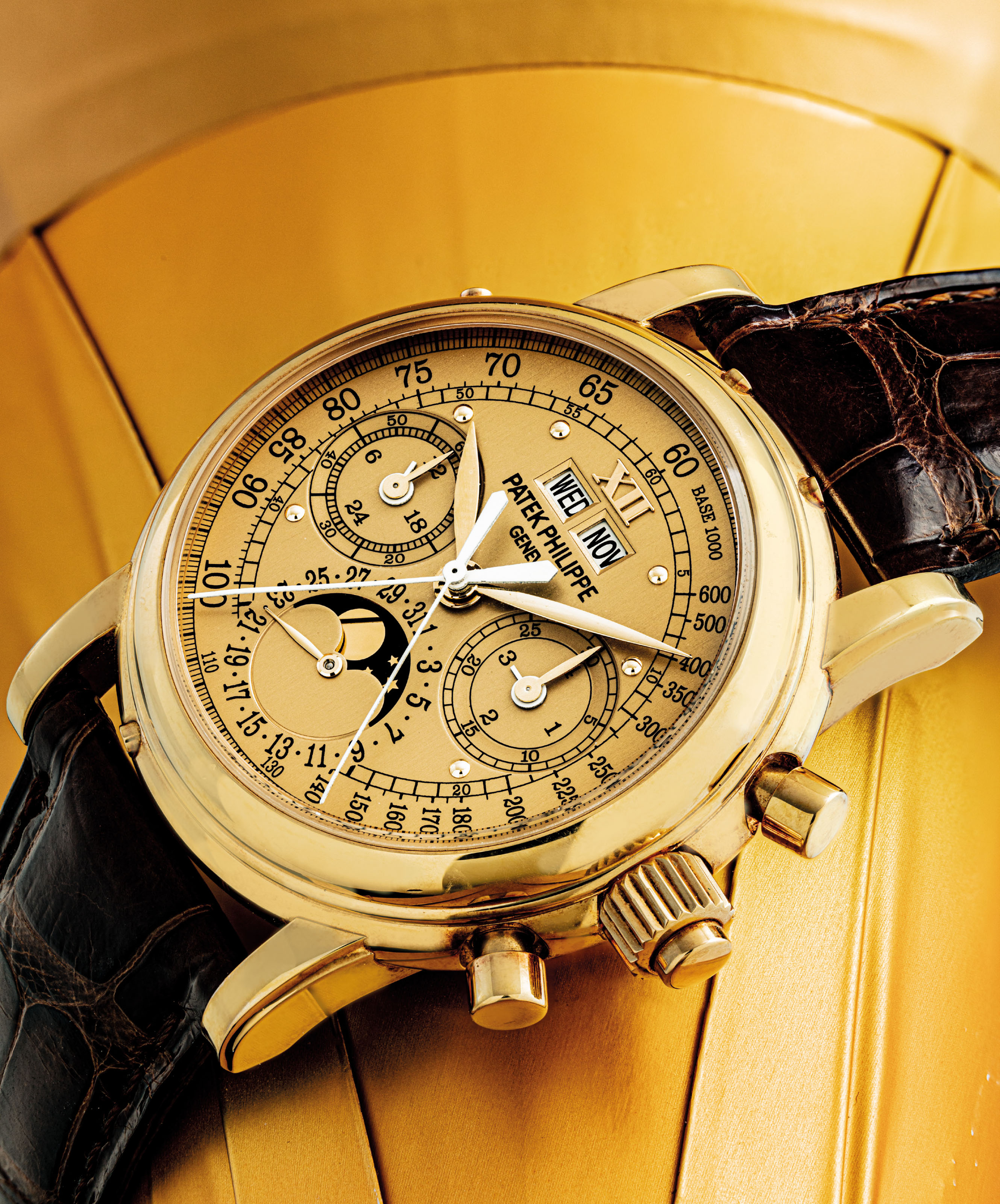 PATEK PHILIPPE. A FINE AND VERY RARE 18K GOLD PERPETUAL CALENDAR SPLIT SECONDS CHRONOGRAPH WRISTWATCH WITH, MOON PHASES, 24 HOUR AND LEAP YEAR INDICATION AND POSSIBLY UNIQUE CHAMPAGNE TACHOMETRE DIAL