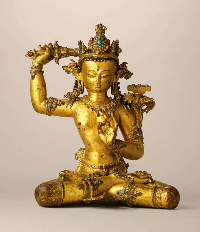 A superbly cast gilt-copper stone-inlaid seated figure of Manjusri, Nepal, 14th century. 9  in. (22.8  cm.) high. Sold for HK$3,965,000 on 29 May 2019 at Christie's in Hong Kong