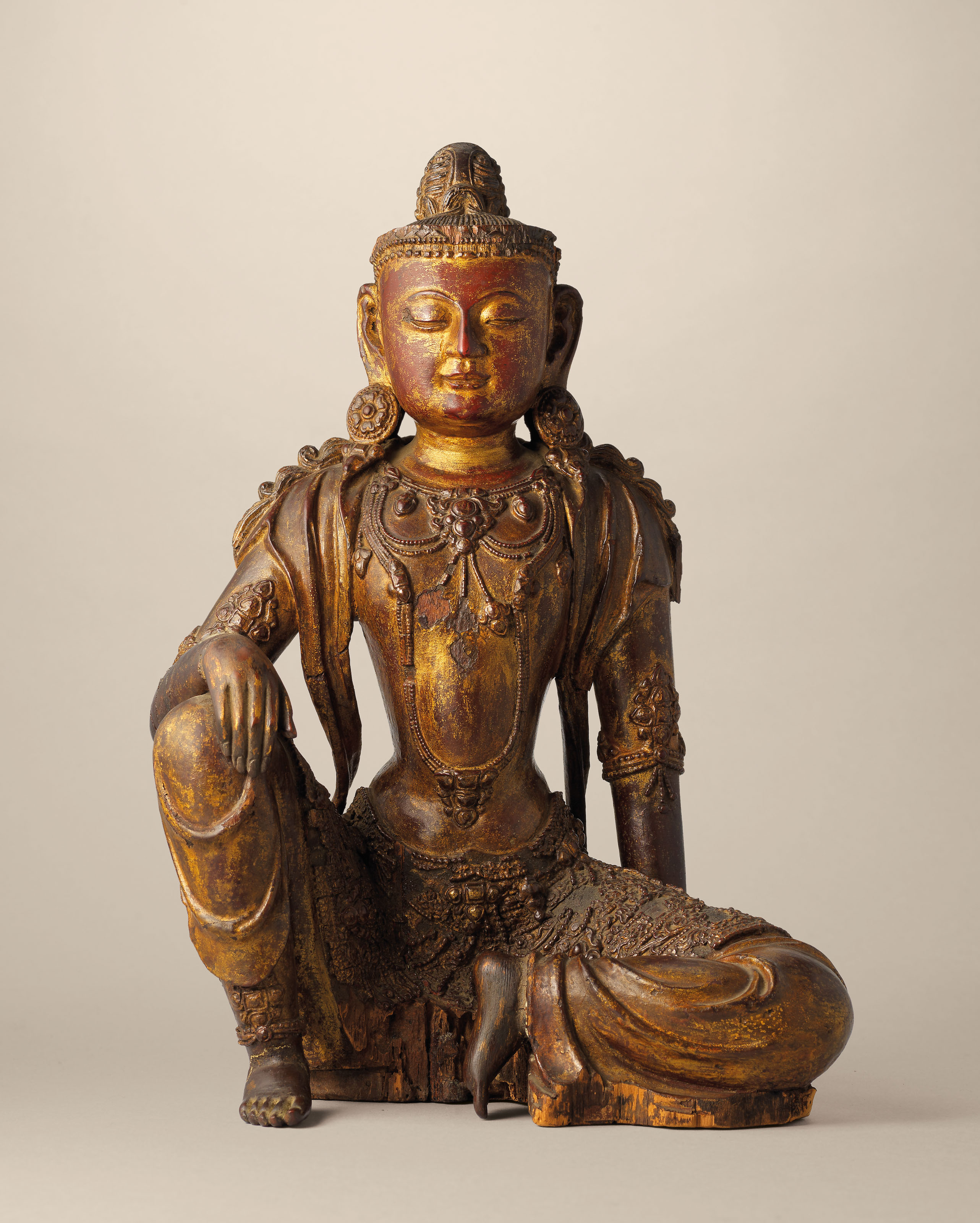 A RARE GILT-LACQUERED WOOD SEATED FIGURE OF A BODHISATTVA