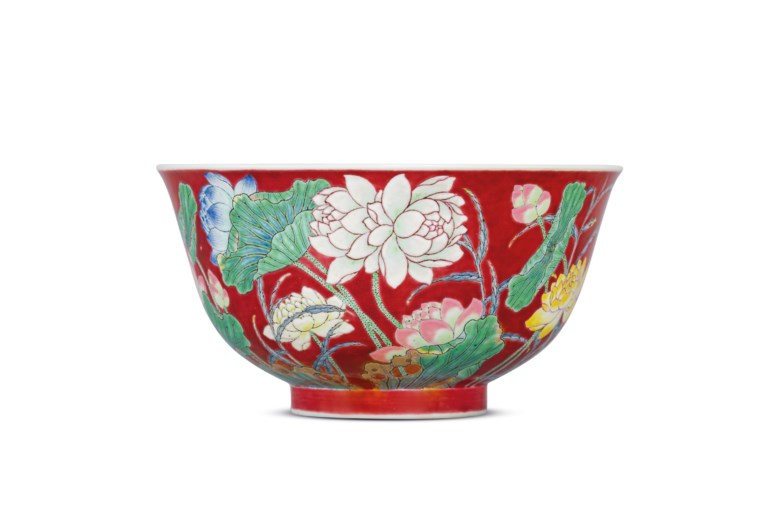 A fine and extraordinary imperial ruby red-ground falangcai 'double lotus' bowl, Kangxi blue-enamelled four-character mark within a double square and of the period, circa 1722. 4⅜  in (11  cm)  diameter, box. Sold for HK$87,200,000 on 27 November 2019 at Christie's in Hong Kong