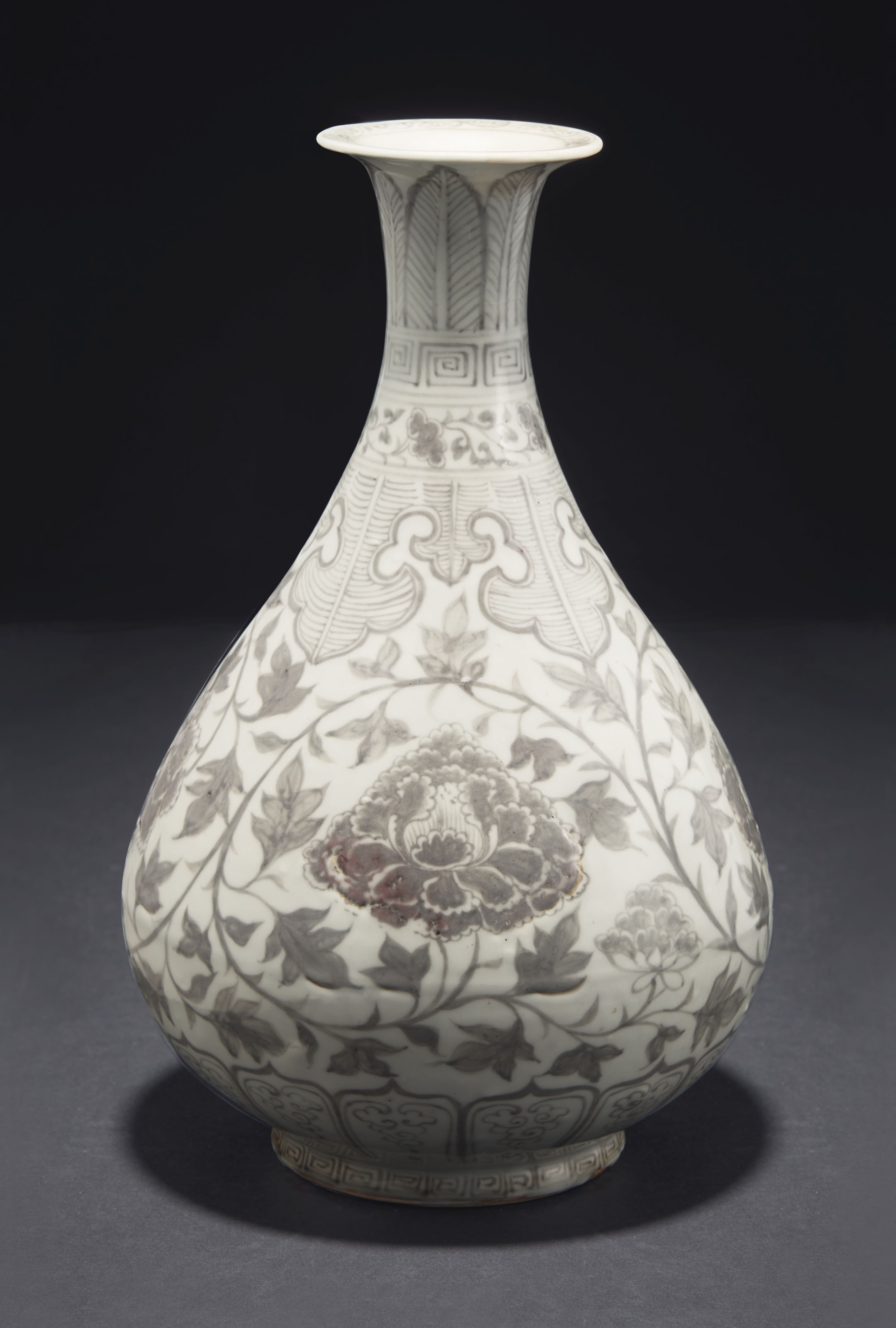 A RARE COPPER-RED-DECORATED 'PEONY SCROLL' BOTTLE VASE, YUHUCHUNPING