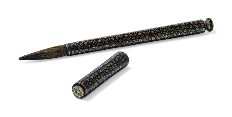 A mother-of-pearl-inlaid black lacquer brush and cover, Ming dynasty, 16th-early 17th century. 8⅞  in (22.6  cm) long, silk pouch, Japanese wood box. Estimate $10,000-15,000. Offered in Fine Chinese Ceramics & Works of Art on 22 March 2019 at Christie's in New York
