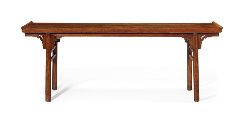 A magnificent and very rare huanghuali painting table, jiatousun hua'an, 17th century. 32 in (81.3 cm) high, 85 in (215.9 cm) wide, 24 in (60.9 cm) deep. Estimate $800,000-1,200,000. Offered in Fine Chinese Ceramics & Works of Art on 22 March 2019 at Christie's in New York