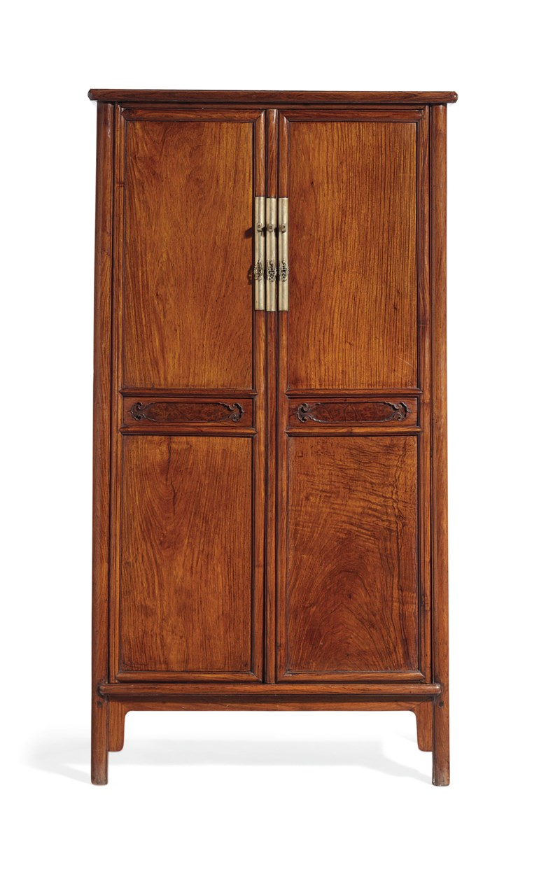 A rare huanghuali and huamu round-corner tapered cabinet, yuanjiaogui, 17th century. 70 in (177.8 cm) high, 36¼ in (92 cm) wide, 19½ in(49.5 cm) deep. Estimate $200,000-300,000. Offered in Fine Chinese Ceramics & Works of Art on 22 March 2019 at Christie's in New York