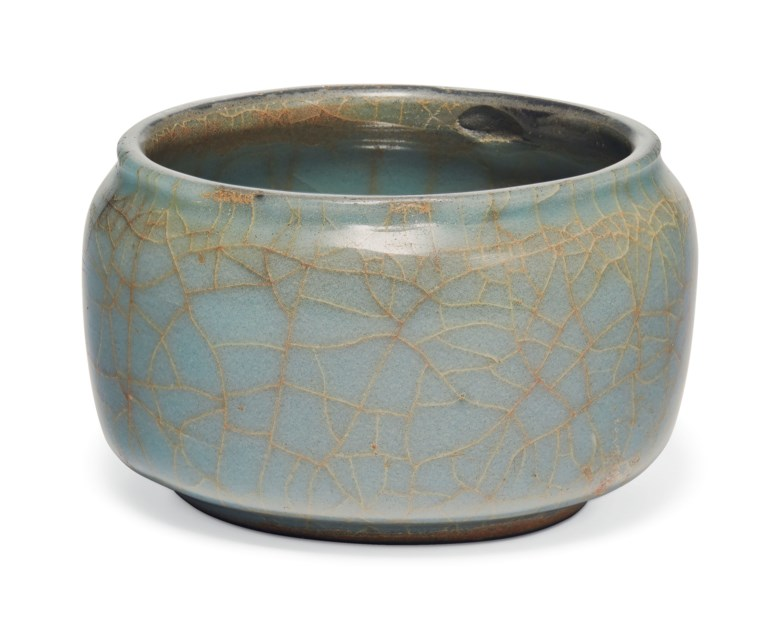 A very rare Guan compressed jar, Southern Song dynasty (1127-1279). 2⅞ in (7.2 cm)  diameter, Japanese wood box. Sold for $106,250 on 22 March 2019 at Christie's in New York