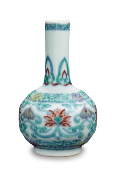 A very rare small doucai lobed 'lotus' vase, Yongzheng six-character mark in underglaze blue within a double circle and of the period (1723-1735). 4 in (10.2 cm) high, hongmu stand and hongmu box. Estimate $200,000-300,000. Offered in Fine Chinese Ceramics & Works of Art on 22 March 2019 at Christie's in New York