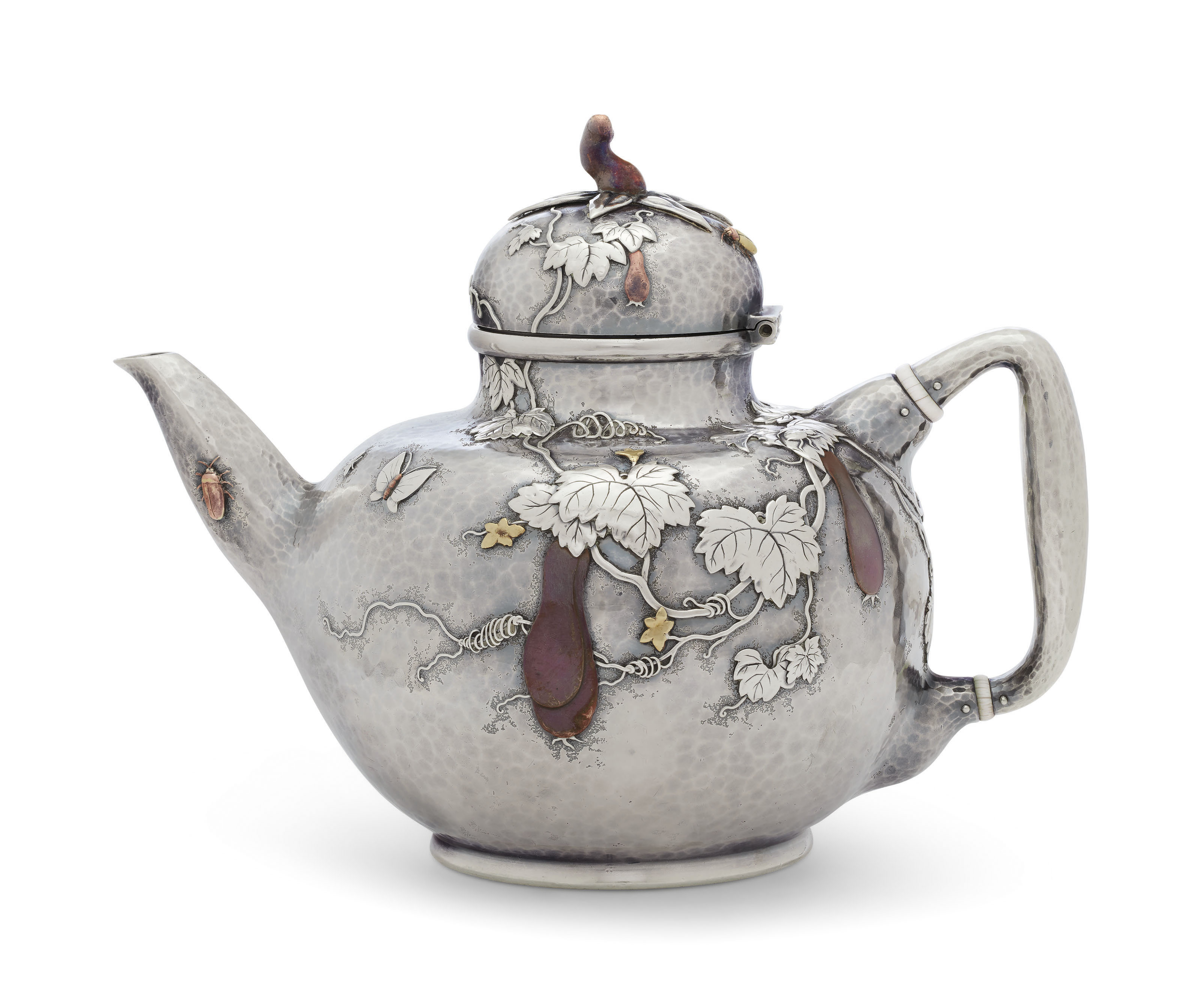 AN AMERICAN SILVER AND MIXED-METAL TEAPOT