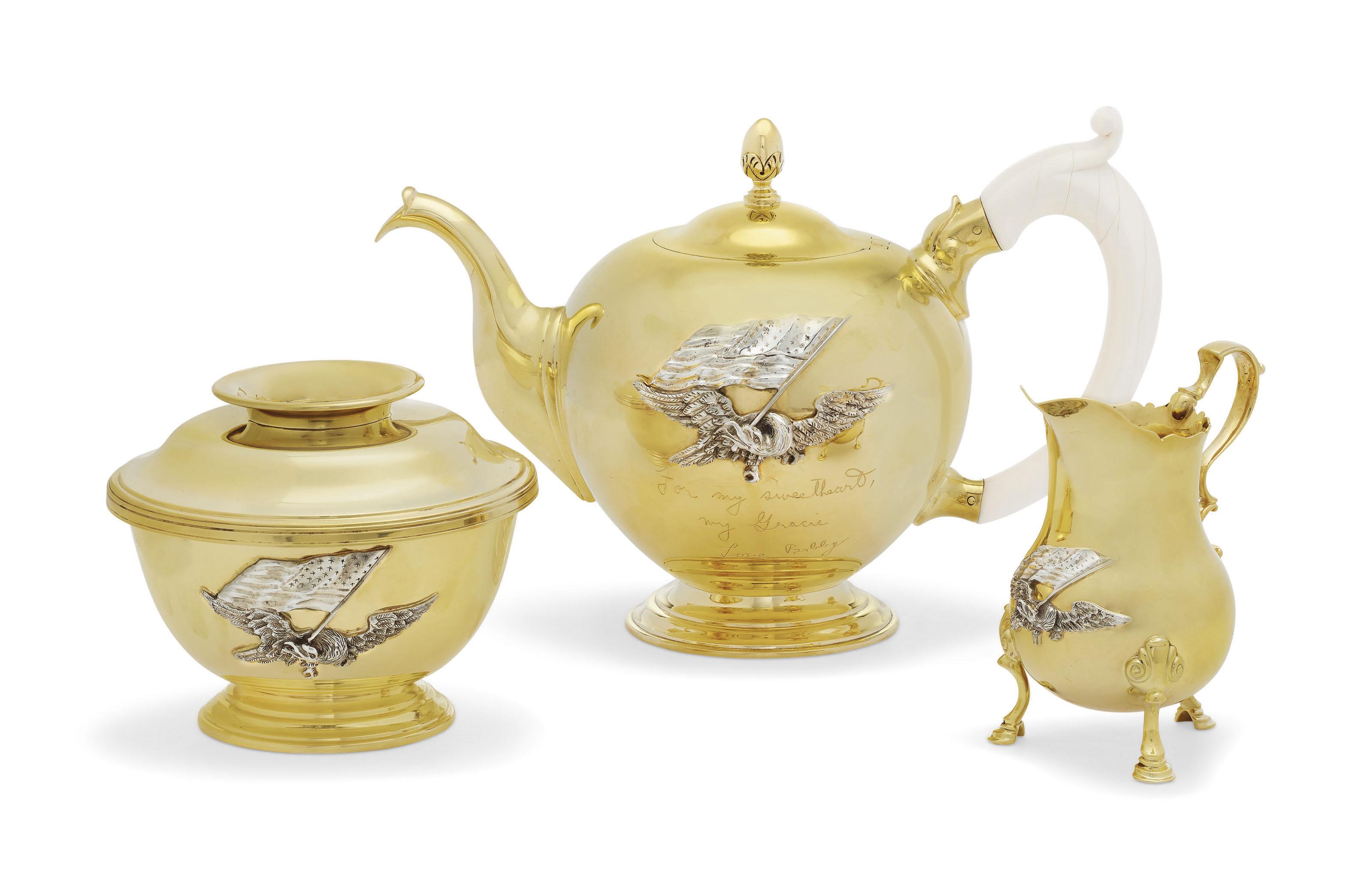 AN AMERICAN SILVER-MOUNTED 18-KARAT GOLD THREE-PIECE TEA SET