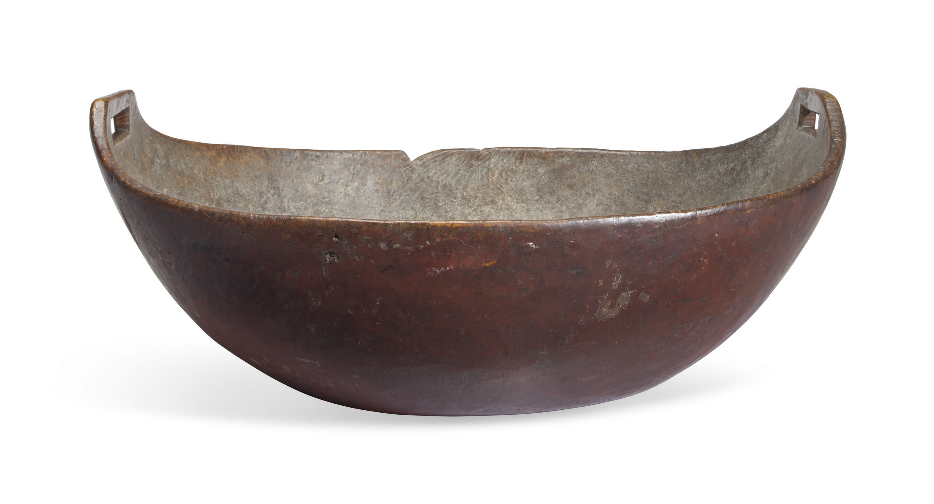 A LARGE NATIVE AMERICAN RED-PAINTED BURLWOOD OPEN-HANDLED BOWL