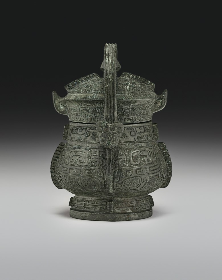 A very rare miniature bronze ritual wine vessel and cover, you, late Shang dynasty, 12th-11th century BC. 4½  in (11.5  cm) high with handle. Estimate $200,000-300,000. Offered in Important Chinese Ceramics and Works of Art on 13 September 2019 at Christie's in New York