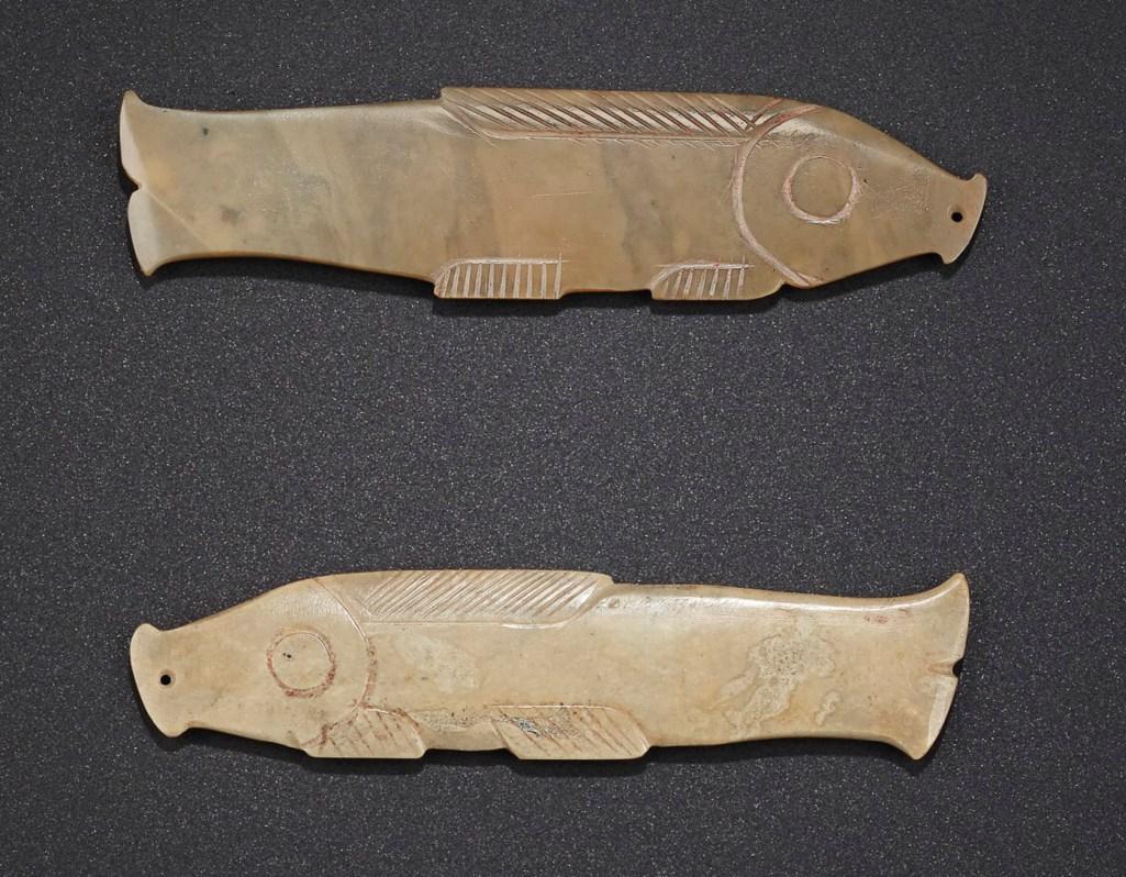 TWO GREENISH-BEIGE JADE FISH-FORM PENDANTS