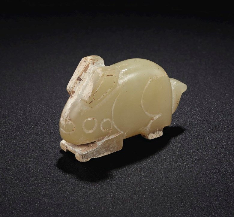 A pale greenish-yellow jade rabbit-form pendant, Late Shang-early Western Zhou dynasty, 12th-11th century BC. 1¾  in (4.5  cm) long. Estimate $25,000-35,000. Offered in Important Chinese Ceramics and Works of Art on 13 September 2019 at Christie's in New York