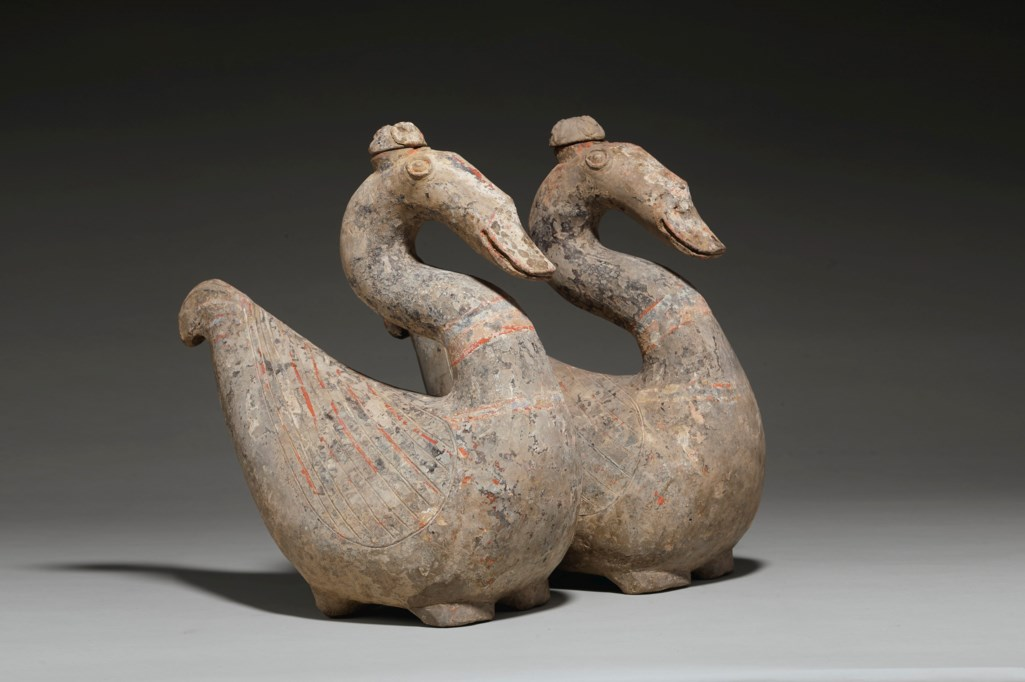 A RARE PAIR OF PAINTED POTTERY GOOSE-FORM VESSELS AND COVERS