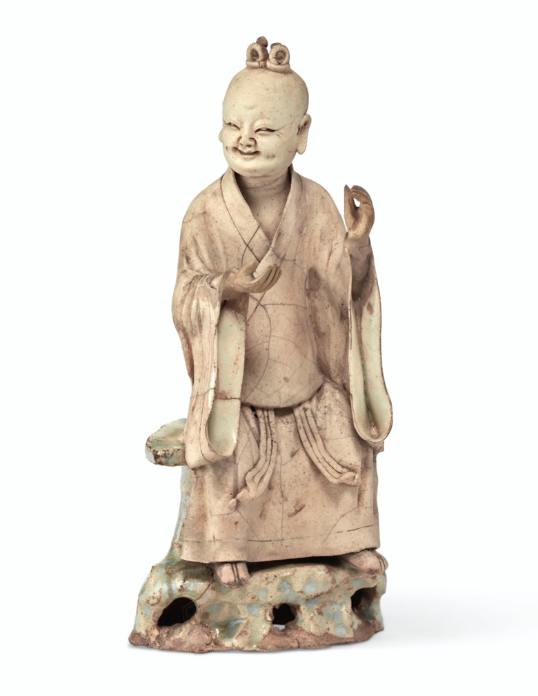 A rare qingbai partially-glazed figure of a Daoist sage, Southern Song dynasty, 13th century. 8  in (20.3  cm) high. Estimate $10,000-15,000. Offered in Important Chinese Ceramics and Works of Art on 13 September 2019 at Christie's in New York