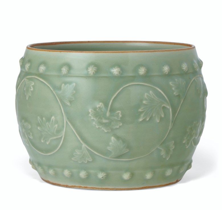 A very rare large Longquan celadon barrel-form jar, Southern Song-Yuan dynasty (1127-1368). 9½  in (23.9  cm)  diameter, lacquer cover, Japanese wood box. Estimate $150,000-250,000. Offered in Important Chinese Ceramics and Works of Art on 13 September 2019 at Christie's in New York
