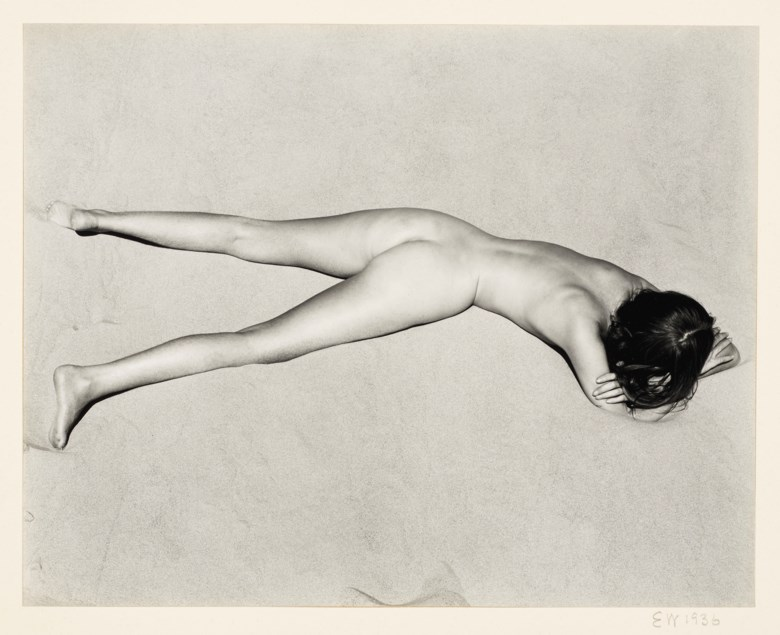 Edward Weston (1886–1958), Nude on Sand, 1936. Gelatin silver print, mounted on card, printed 1940s. Mount 14 x 15½  in (35.5 x 39.3  cm). Estimate $70,000-90,000. This lot is offered in Photographs on 2 April 2019 at Christie's in New York