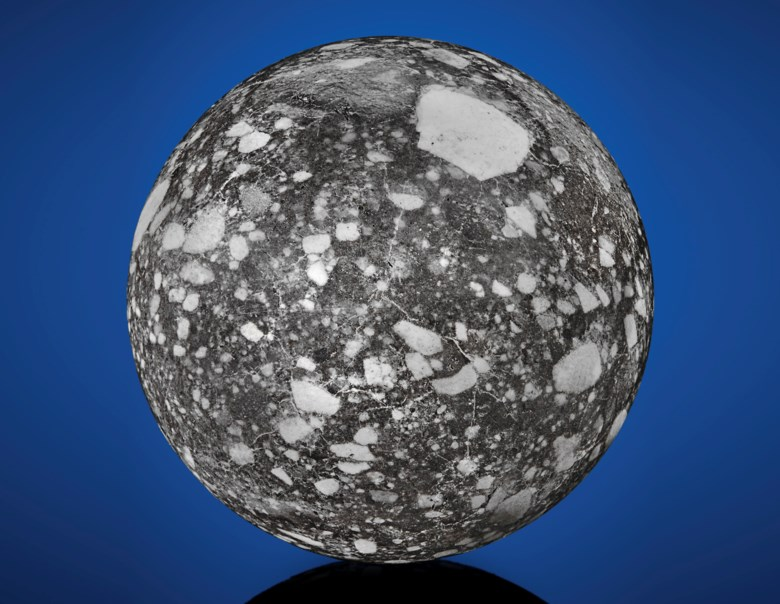 NWA 12691 — rare lunar sphere — from the NWA 8046 clan of lunar meteorites, lunar feldspathic breccia, Sahara Desert, Mauritania. Estimate $35,000-55,000. Offered in  The Moon and Beyond Meteorites from the Stifler Collection, 11-19 July 2019, Online