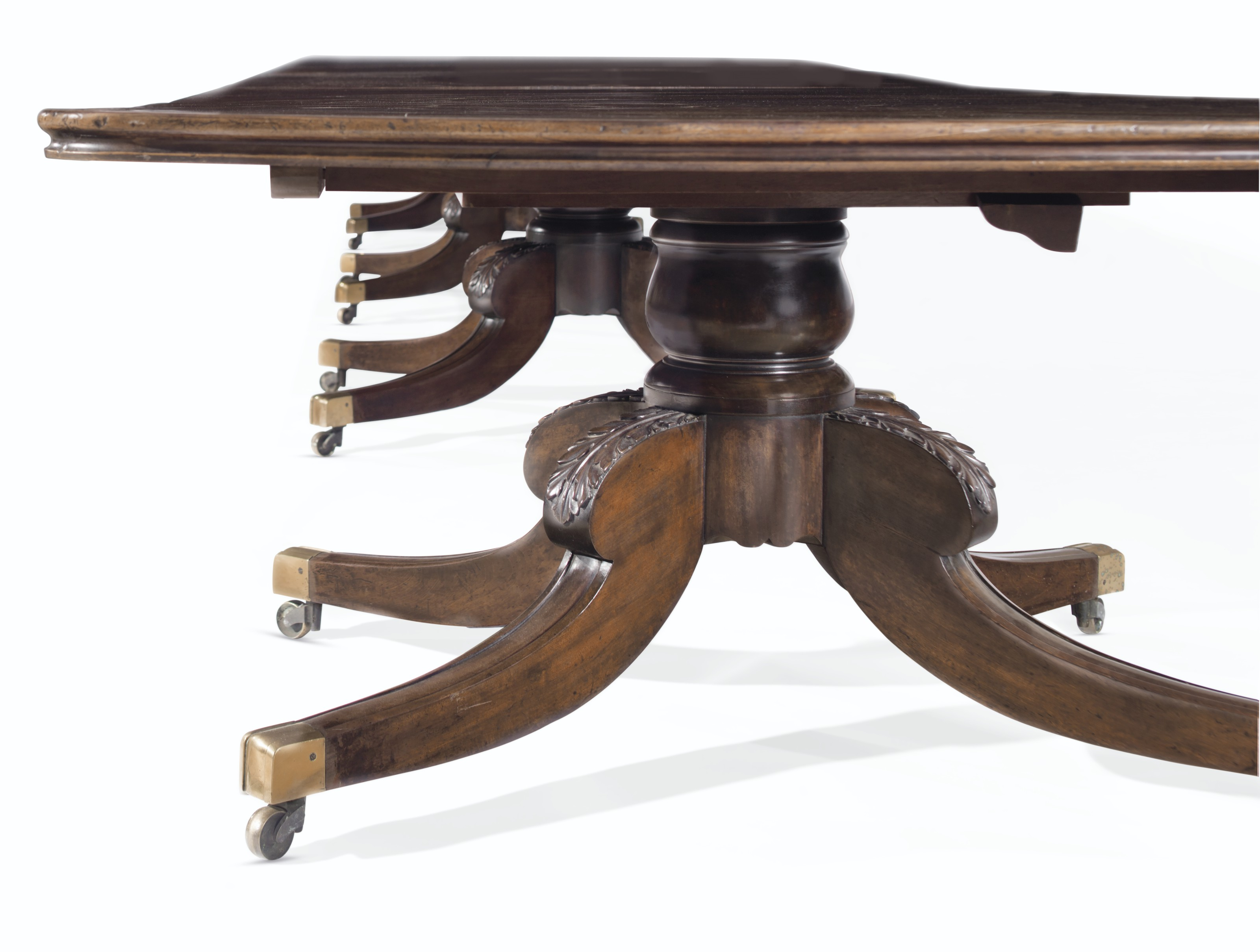 AN IRISH WILLIAM IV MAHOGANY FOUR-PEDESTAL EXTENSION DINING TABLE