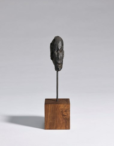 Alberto Giacometti (1901-1966), Tête dhomme, conceived circa 1948-1950 and cast in 1986. Overall bronze height 8⅜  in (21  cm). Sold for $187,500 on 13 May 2019 at Christie's in New York; 2019 Alberto Giacometti Estate  Licensed by VAGA and ARS, New York