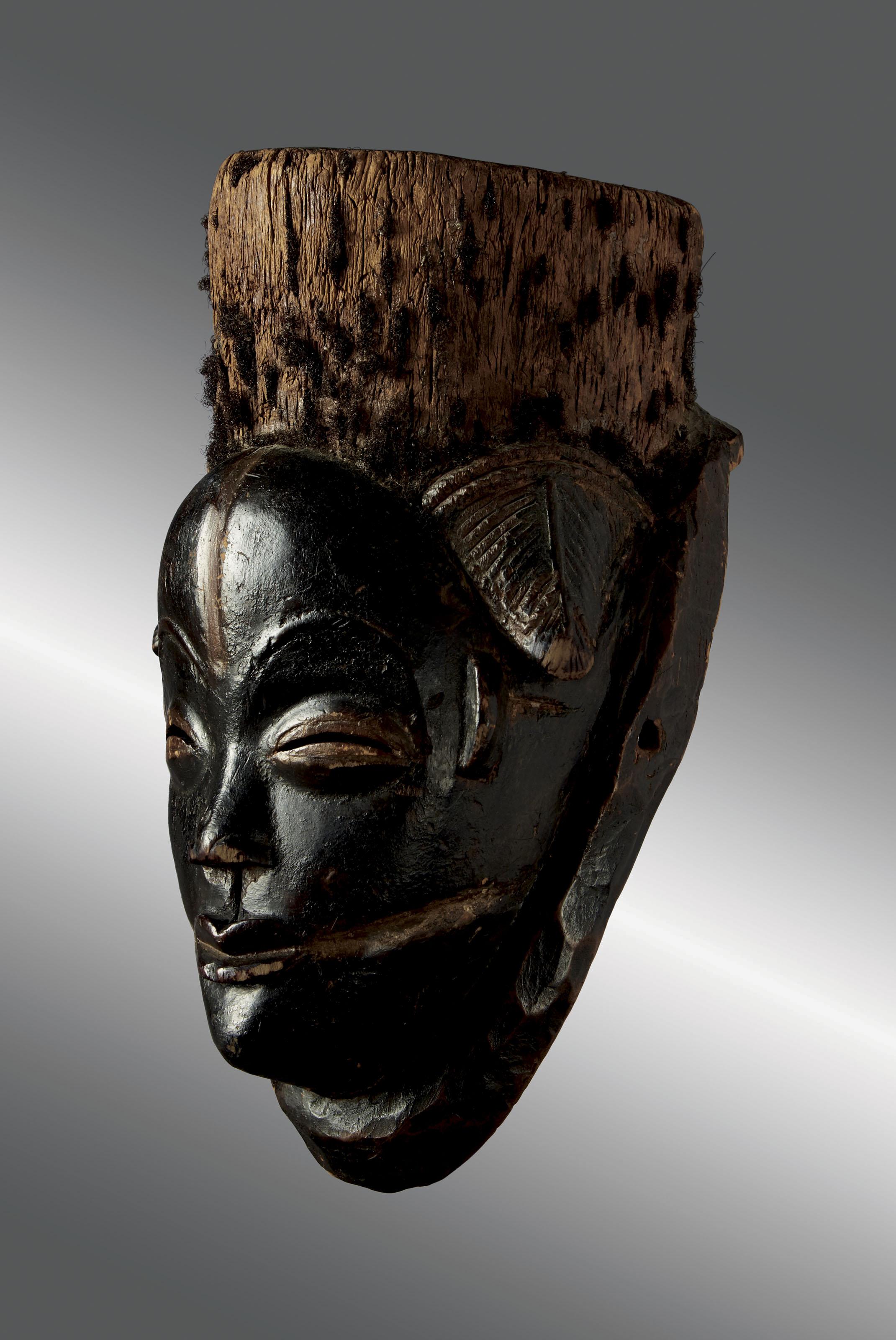 A BLACKENED PUNU MASK, IKWARA