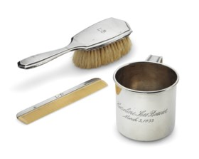 AN AMERICAN SILVER CHILD'S MUG, HAIRBRUSH, AND COMB