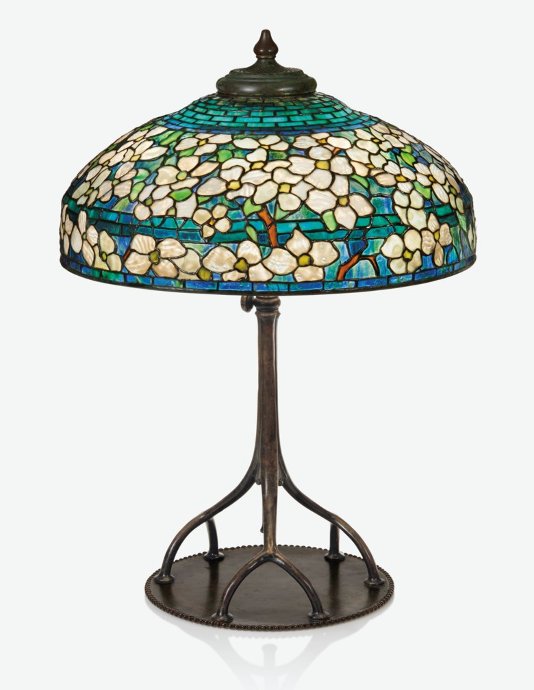 Tiffany Studios, 'Dogwood' table lamp, circa 1904-1905. 22½ in (57.1 cm) diameter of shade. Estimate $80,000-120,000. Offered in Design on 4 June 2019 at Christie's in New York