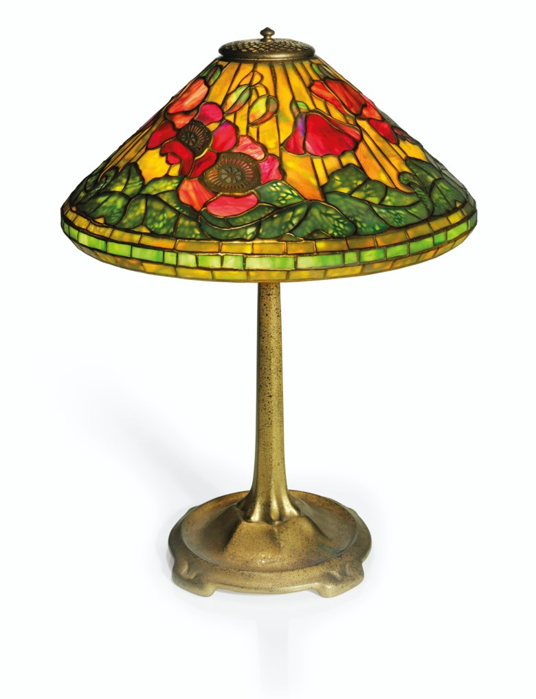 Tiffany Studios, a 'Poppy' table lamp, circa 1915. 21¾  in (55.2  cm) high; 16½  in (41.9  cm) diameter. Estimate $30,000-50,000. This lot is offered in Interiors on 21-22 August 2019 at Christie's in New York