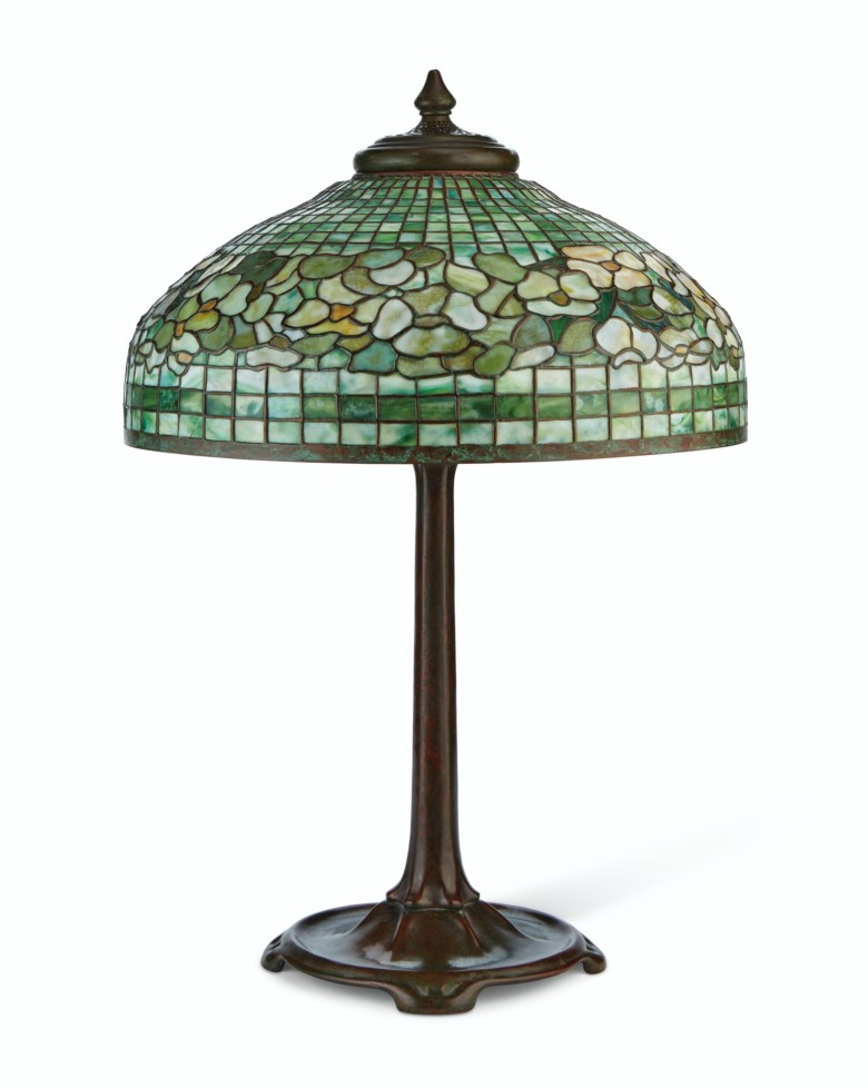 Tiffany Studios, a 'Banded Dogwood' table lamp, circa 1910. 29½  in (74.9  cm) high; 20¼  in (51.4  cm) diameter. Sold for $25,000 in Interiors on 21-22 August 2019 at Christie's in New York