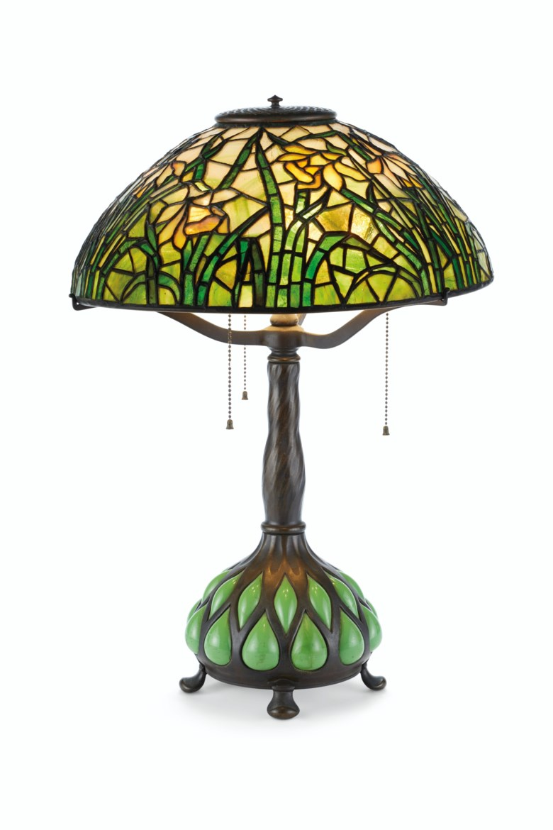 Tiffany Studios, a 'Daffodil' table lamp, circa 1910. 16  in (40.6  cm) diameter; 23¾  in (60.4  cm) high. Estimate $10,000-15,000. This lot is offered in Interiors on 21-22 August 2019 at Christie's in New York