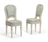 A PAIR OF LOUIS XVI WHITE-PAINTED WALNUT CHAISES