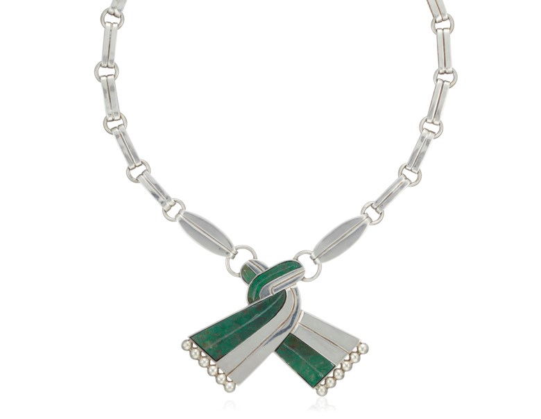 William Spratling malachite and silver pendant necklace. Dimensions 48.5 cm length, 5.5 cm drop. Estimate $1,000-1,500. Offered in  Christies Jewels Online, 10-18 April 2019, Online